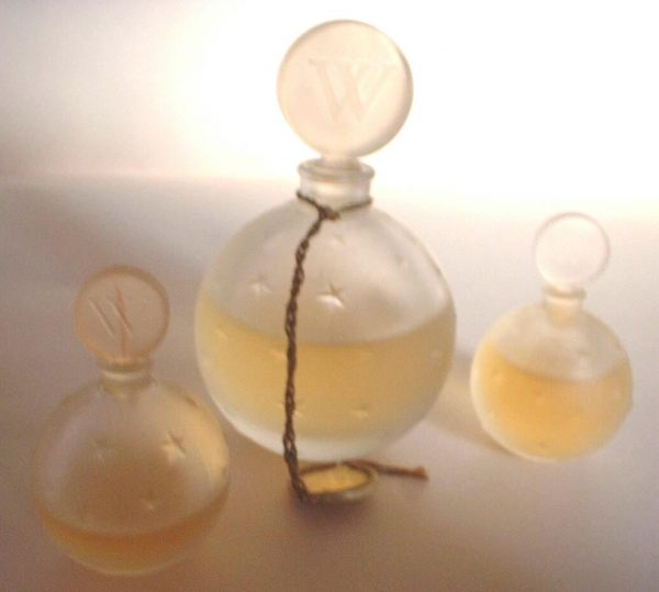 Boule bottles of Je Reviens perfume from Worth